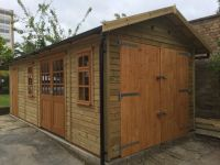 10 x 24 Garage with garden room doors and windows plus storage shed at the end.