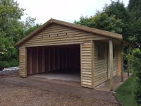 Feather Edge garage with a 1m canopy style log store