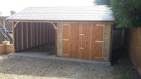 Cart lodge garage with a Tapco Slate Roof