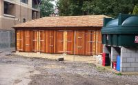 Cedar cladding with Cedar Double Doors and Cedar Shingles. Complete with a full hipped roof.