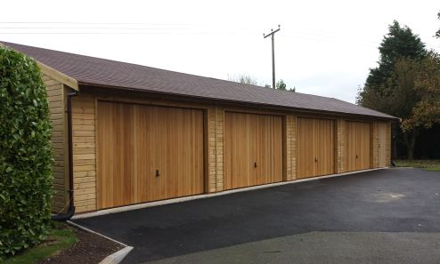 50 x 20 Garage with Cedar infill U&O doors, and a small workshop at the end of the 4 bays.