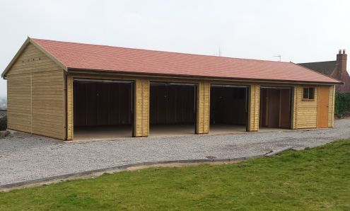 A 50 x 20 Garage with a RED Tapco roof and 4 x up & over doors.