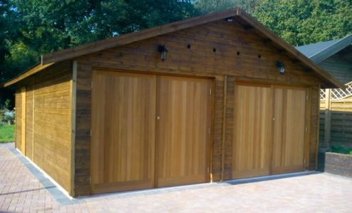 EVERYONE IS DIFFERENT & SO ARE WARWICK BUILDINGS A 20 x 26 Warwick Buildings Double Garage with electrically operated Cedar Infill Double Doors. Contact us for further details