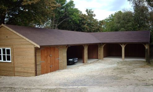 Five Bay L Shaped Garage with large integral storage area. The Red/Brown Felt Tile Roof has been designed to carry solar panels